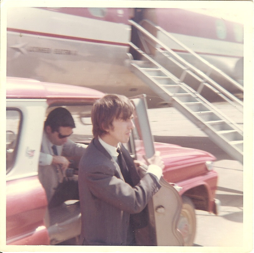 George Harrison heading to the plane in Walnut Ridge